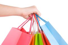 woman hand holding several shopping bags isolated on white. - stock photo
