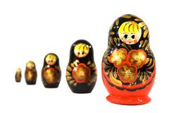 Stock Photo of Russian dolls is sequence isolated on white