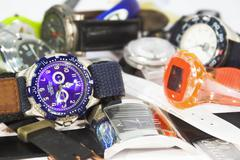 Pile of various wrist watches Stock Photos
