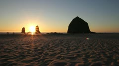 Sunset with Haystack Rocks in Cannon Beach Oregon 1080p at Lowtide Panning Stock Footage