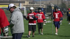 Sports & fitness, lacrosse game, players walking to coach Stock Footage