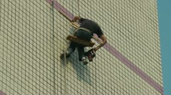 Workers Working at height Stock Footage
