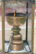 Stock Photo of buddhist altar lamp