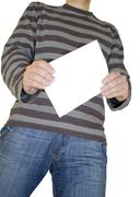Man holding white paper - stock photo