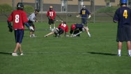 Stock Video Footage of lacrosse game, face-off to shot on net