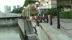 Bronze sculpture along Singapore River Stock Footage