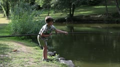Boy fishing other side Stock Footage