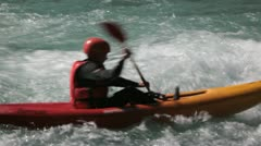 Beginner in kayak practices in current Stock Footage