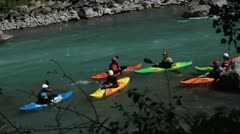 Group of canoers move on a fast flowing river Stock Footage