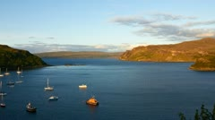 Sunset over loch portree, isle of skye, scotland Stock Footage