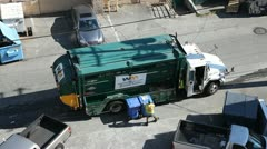 Recycle garbage truck picks up containers Stock Footage