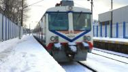 Train running through the station in snow Stock Footage
