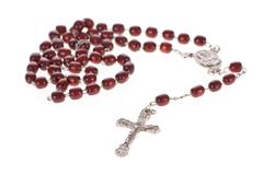 rosary beads isolated over a white background - stock photo