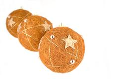 Three christmas balls hanging and isolated on white Stock Photos