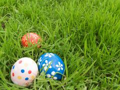 easter eggs hidden in the grass - stock photo