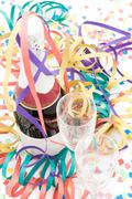Champagne bottle and flutes on a party setting. Stock Photos