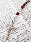 Rosary over an old holy bible. Stock Photos