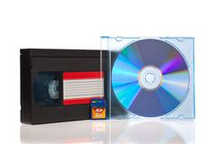 Old video cassette tapes with dvd discs isolated on white background Stock Photos