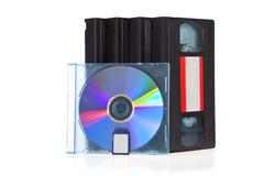 old video cassette tape, with a dvd disc and flash memory card isolated on wh - stock photo