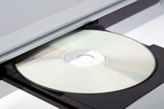 close up of a dvd player ejecting disc - stock photo