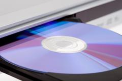 Close up of a dvd player ejecting disc . Stock Photos