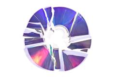 shattered dvd / cd isolated on a white background - stock photo