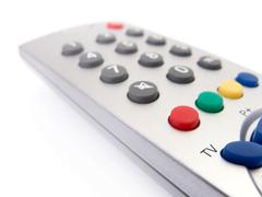 close up of a tv remote control on white. - stock photo
