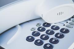 Office telephone. Detail of earpiece and keypad. Stock Photos