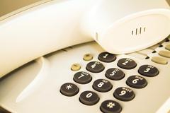Office telephone. Detail of earpiece and keypad. - stock photo