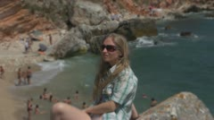 Beautiful young woman relaxing near to a beach Stock Footage