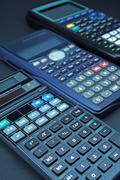 Set of various scientific calculators. Stock Photos
