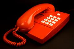 red telephone isolated on black - stock photo