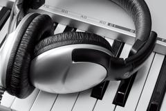 Headphones on synthesizer keyboard - stock photo