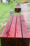 Stock Photo of benches by wooden road