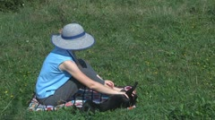 Beautiful woman relax playing with her playful dog in garden on rural pasture Stock Footage