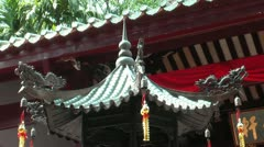 Taoist temple green glazed roof tiles with religious decoration. Stock Footage