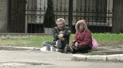 Beggars on the street. Man and woman. - stock footage