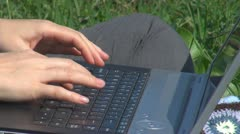 Woman working on laptop on the grass, girl, close-up, succes, garden, holiday Stock Footage