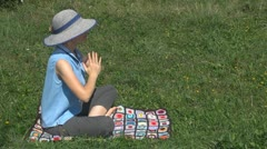 Beautiful woman doing yoga on the grass, lady, girl, rural, meditation, paradise Stock Footage