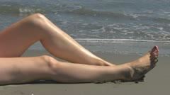 Woman relaxing on the beach holiday leg ocean island sand summer female girl Stock Footage
