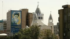 Church and building with Khomeini painting. Stock Footage