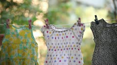 Young Adult Woman Collects Laundry Stock Footage