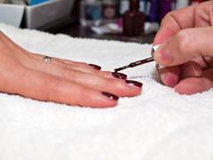 Painting nails close up Stock Photos
