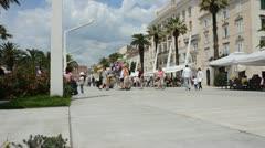 Tourists wander along the promenade in Split, Croatia Stock Footage