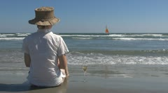 Woman drinking white wine on the beach girl sand lady sand relax sitting resort Stock Footage