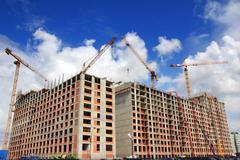 working construction cranes - stock photo