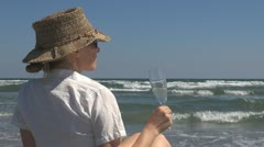Young woman drinking white wine on the beach, champagne fresh lifestyle enjoy  Stock Footage
