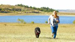 Young Woman Running With her Dog Outdoor Stock Footage
