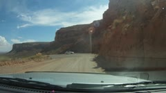 Precarious switch back dirt road coming of high desert into Mexican Hat - 8 Stock Footage