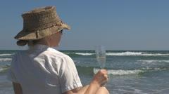 Beautiful woman drinking white wine on the beach celebration lifestyle ocean sea Stock Footage